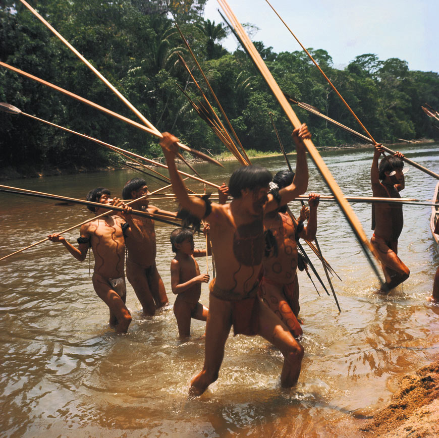 A group of armed Yanomami raiders from the Bisaasa-teri village in the Orinoco river.